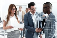 Business handshake business people in the office. royalty free stock photos