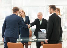 Business handshake and business people. Business people shaking hands, finishing up a meeting Stock Images