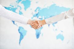 Business handshake and business people.Vintage tone Retro filter effect,soft focus,low light. Royalty Free Stock Photography
