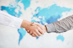 Business handshake and business people.Vintage tone Retro filter effect,soft focus,low light. Royalty Free Stock Image