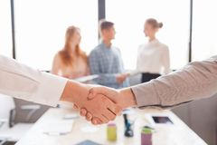 Business handshake and business people.Vintage tone Retro filter effect,soft focus,low light. stock images