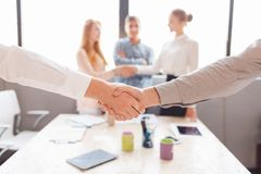 Business handshake and business people.Vintage tone Retro filter effect,soft focus,low light. Stock Photos