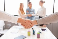 Business handshake and business people.Vintage tone Retro filter effect,soft focus,low light. Royalty Free Stock Photo