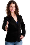 Business Handshake. Businesswoman, in a suite, ready to give an handshake, isolated in white Stock Photos