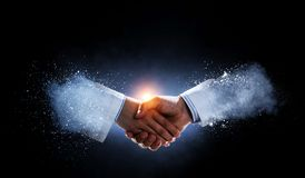 Business Handshake By A Man And A Woman. Royalty Free Stock Photography
