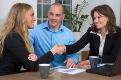 Business handshake among caucasian group stock images