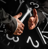 Business Handshake with Clock Overlays Stock Photography