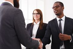 Multiethnic. Business handshake closeup, contract conclusion and successful agreement concept. Crop image Royalty Free Stock Images