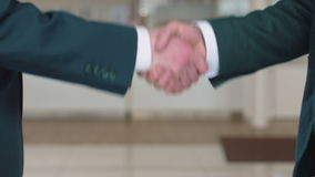 Business handshake of colleagues stock footage