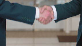 Business handshake of colleagues stock video