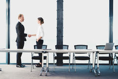 Business handshake. Concept of teamwork and partnership. Business handshake of businessman and businesswoman. Concept of teamwork and partnership stock photo