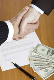 Business handshake after contract signature Stock Photo