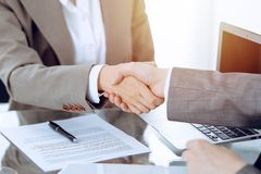 Business handshake after contract signing. Two women shaking hands after meeting or negotiation.  royalty free stock image