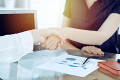 Business handshake after contract signing. Two women shaking hands after meeting or negotiation. Casual style of. Business handshake. Two women shaking hands stock photo