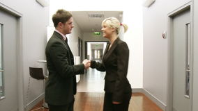 Business handshake in a corridor Stock Photography