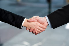 Business handshake, deal finalized. Successful business people shaking hands after closing a deal Stock Images