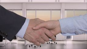 Business handshake after deal in modern office with sunset over the sea outside the window stock video footage