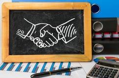 Business handshake drawn on blackboard Royalty Free Stock Images