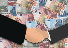 Business handshake on euros Royalty Free Stock Images