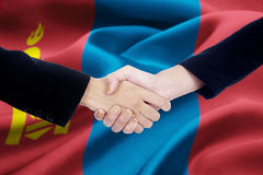 Business handshake with flag of Mongolia Royalty Free Stock Photo