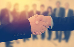Business handshake in front of business people background Royalty Free Stock Photos