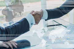 Business handshake with globalization concept Stock Photos