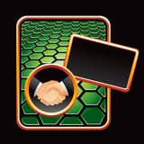 Business handshake on green hexagon ad Royalty Free Stock Photo