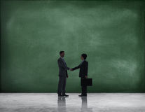 Business Handshake with Green Textured Background Royalty Free Stock Image