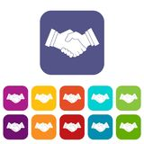 Business handshake icons set flat. Business handshake icons set vector illustration in flat style In colors red, blue, green and other Stock Images