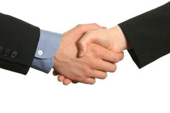Business handshake male and female. A man's hand in business attire shakes the hand of a woman in business attire isolated on white space Stock Image
