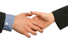 Business handshake, man and woman. A businessman's hand ready to grasp a businesswoman's hand in handshake isolated on white space Royalty Free Stock Image