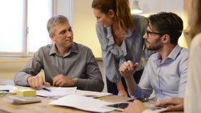 Business handshake during meeting stock footage