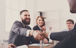 Business handshake at multiethnic office meeting, contract conclusion Royalty Free Stock Images