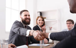 Business handshake at multiethnic office meeting, contract conclusion Royalty Free Stock Photo