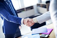 Business handshake in the office stock image