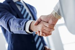 Business handshake in the office royalty free stock photography