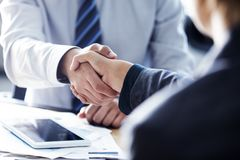 Business handshake in the office royalty free stock images