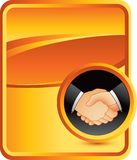 Business handshake on orange background Royalty Free Stock Photo