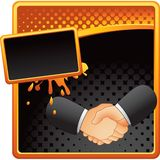 Business handshake on orange and black halftone ad Royalty Free Stock Photography