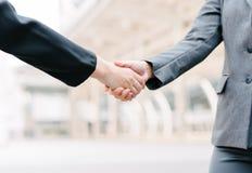 business handshake outdoor stock image