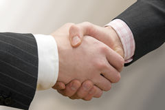 Business handshake over blurry background Stock Photography
