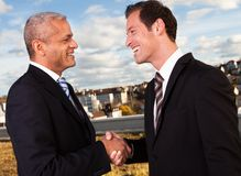 Business handshake over the deal Stock Images