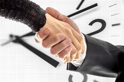 Business handshake over white clock Royalty Free Stock Images