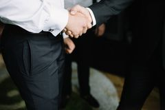 Business handshake and business people. Business men giving a handshake. Business concept Royalty Free Stock Photos