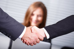 Business handshake. Business people shaking hands as agreement Royalty Free Stock Image
