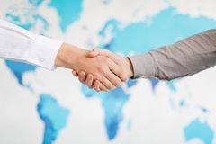 Business handshake and business people.Vintage tone Retro filter effect,soft focus,low light. Stock Photo
