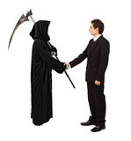 Business handshake with reaper Royalty Free Stock Photography