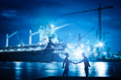 Business handshake in shipyard, shipbuilding company. Industry, deal, contract Stock Images