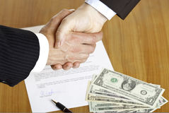 Business handshake after signed contract Stock Images