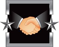 Business handshake in silver star frame Stock Photos